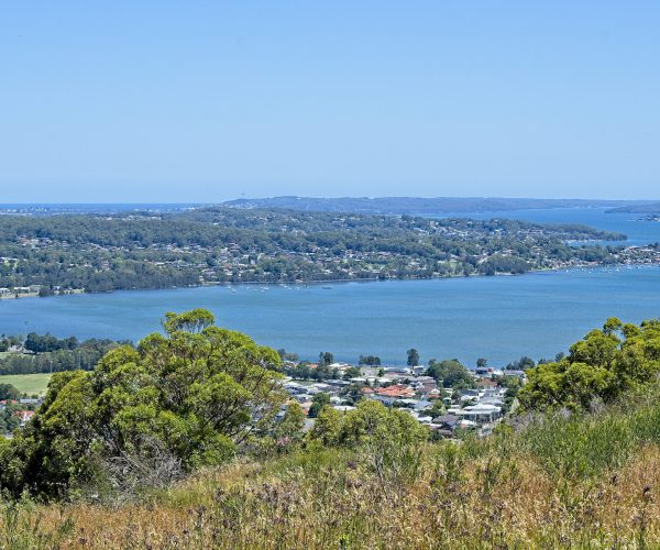Looking across Lake Macquarie with Warners Bay centre left, Belmont and Swansea on the horizon, Eleebana Point and Valentine Point centre right